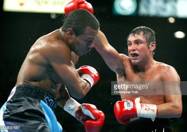 9e8f286ceaa5 Shane Mosley blue trunks fights Oscar De La Hoya black trunks during a  12round WBC