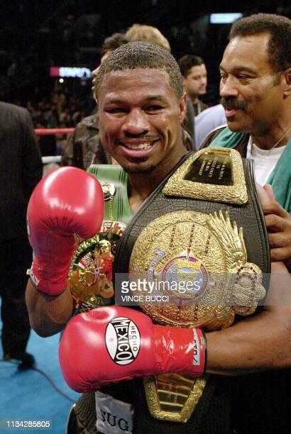 Shane Mosley celebrates with his father and trainer Jack Mosley showing his WBC World Welterweight Championship belt after beating Oscar de la Hoya...