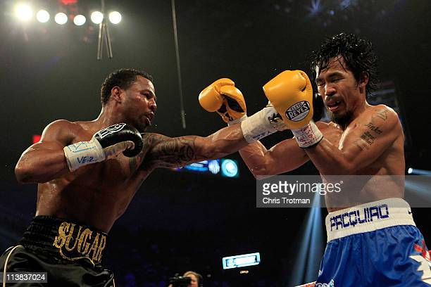 Shane Mosley connects with a left to the face of Manny Pacquiao of the Philippines in the WBO welterweight title fight at MGM Grand Garden Arena on...