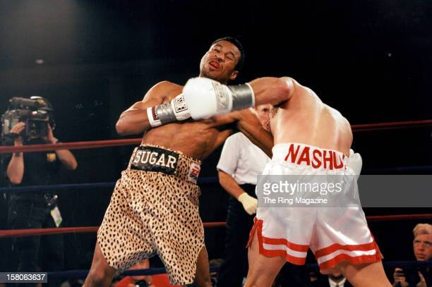 Shane Mosley lands a left hook against Philip Holiday during the fight at Mohegan Sun Casino, on August 2,1997 in Uncasville, Connecticut. Shane...