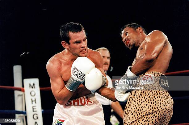 Shane Mosley lands a right hook against Philip Holiday during the fight at Mohegan Sun Casino, on August 2,1997 in Uncasville, Connecticut. Shane...