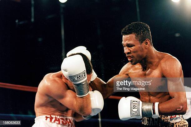 Shane Mosley lands a right punch against Philip Holiday during the fight at Mohegan Sun Casino, on August 2,1997 in Uncasville, Connecticut. Shane...