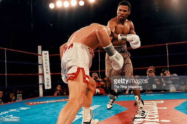 Shane Mosley throws a right hook against Philip Holiday during the fight at Mohegan Sun Casino on August 21997 in Uncasville Connecticut Shane Mosley...