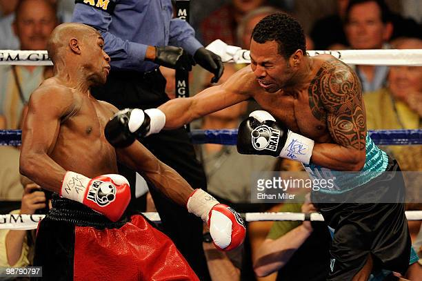 Shane Mosley throws a right to the head of Floyd Mayweather Jr as Mayweather Jr dodges it during the welterweight fight at the MGM Grand Garden Arena...
