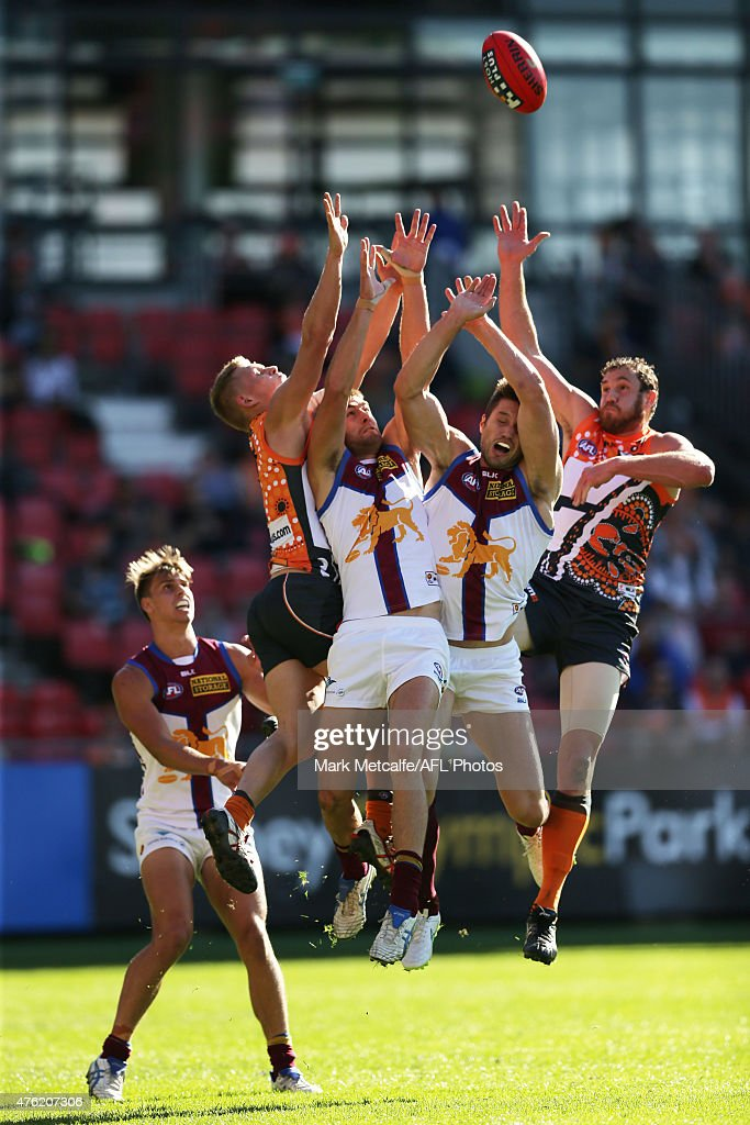 Shane Mumford and Adam Treloar of the Giants compete for a mark with Zac O'Brien of the Lions during the round 10 AFL match between the Greater Western Sydney Giants and the Brisbane Lions at Spotless Stadium on June 7, 2015 in Sydney, Australia.