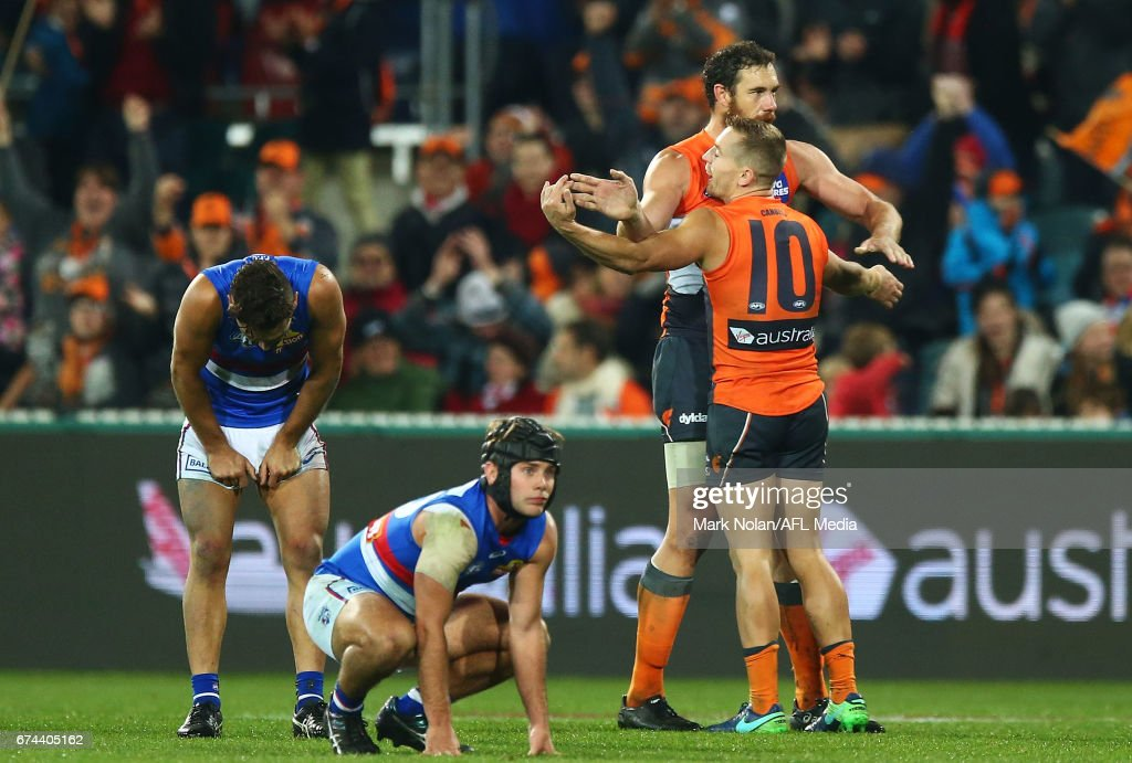 Shane Mumford and Devon Smith of the Giants celebrate winning the round six AFL match between the Greater Western Sydney Giants and the Western Bulldogs at UNSW Canberra Oval on April 28, 2017 in Canberra, Australia.