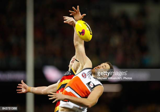 Shane Mumford of the Giants and Josh Jenkins of the Crows compete for the ball during the AFL First Qualifying Final match between the Adelaide Crows...