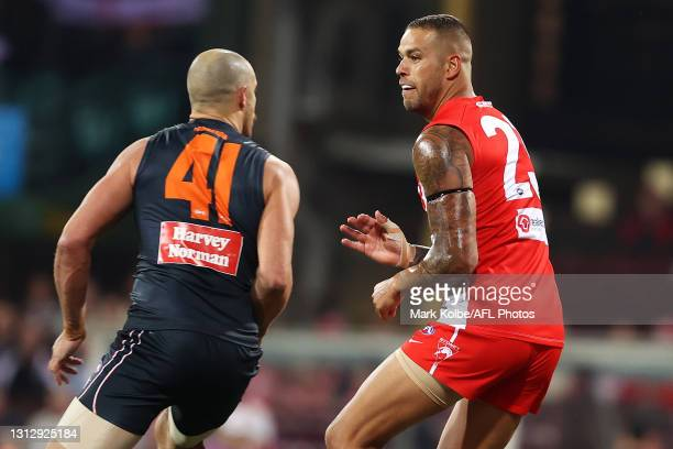 Shane Mumford of the Giants and Lance Franklin of the Swans bump each other off the ball during the round five AFL match between the Sydney Swans and...