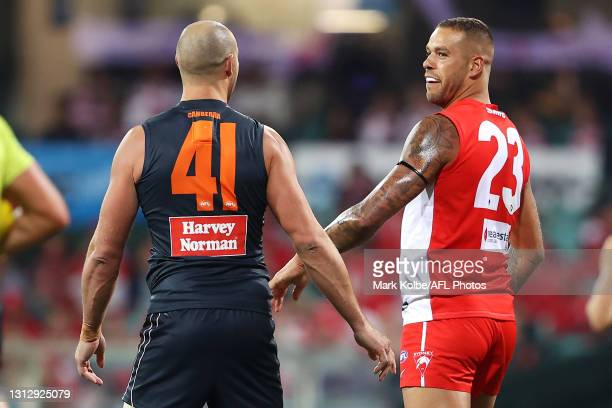 Shane Mumford of the Giants and Lance Franklin of the Swans exchange heated words during the round five AFL match between the Sydney Swans and the...