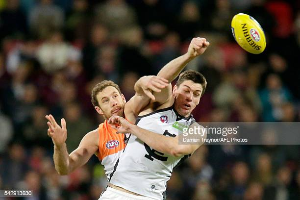 Shane Mumford of the Giants and Matthew Kreuzer of the Blues compete in the ruck during the round 14 AFL match between the Greater Western Sydney...