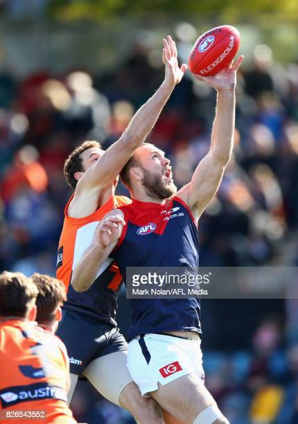 Shane Mumford of the Giants and Max Gawn of the Demons contest possession during the round 20 AFL match between the Greater Western Sydney Giants and...