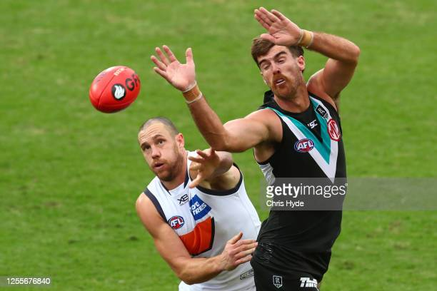 Shane Mumford of the Giants and Scott Lycett of the Power compete for the ball during the round 6 AFL match between the Port Adelaide Power and the...