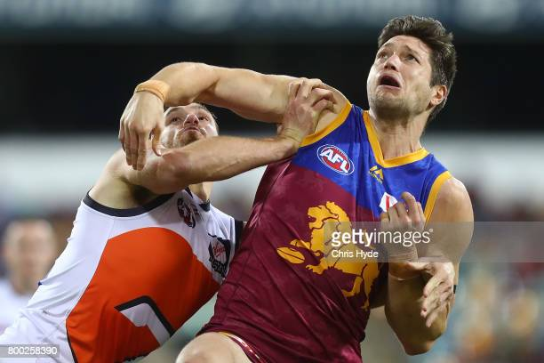 Shane Mumford of the Giants and Stefan Martin of the Lions compete for the ball during the round 14 AFL match between the Brisbane Lions and the...