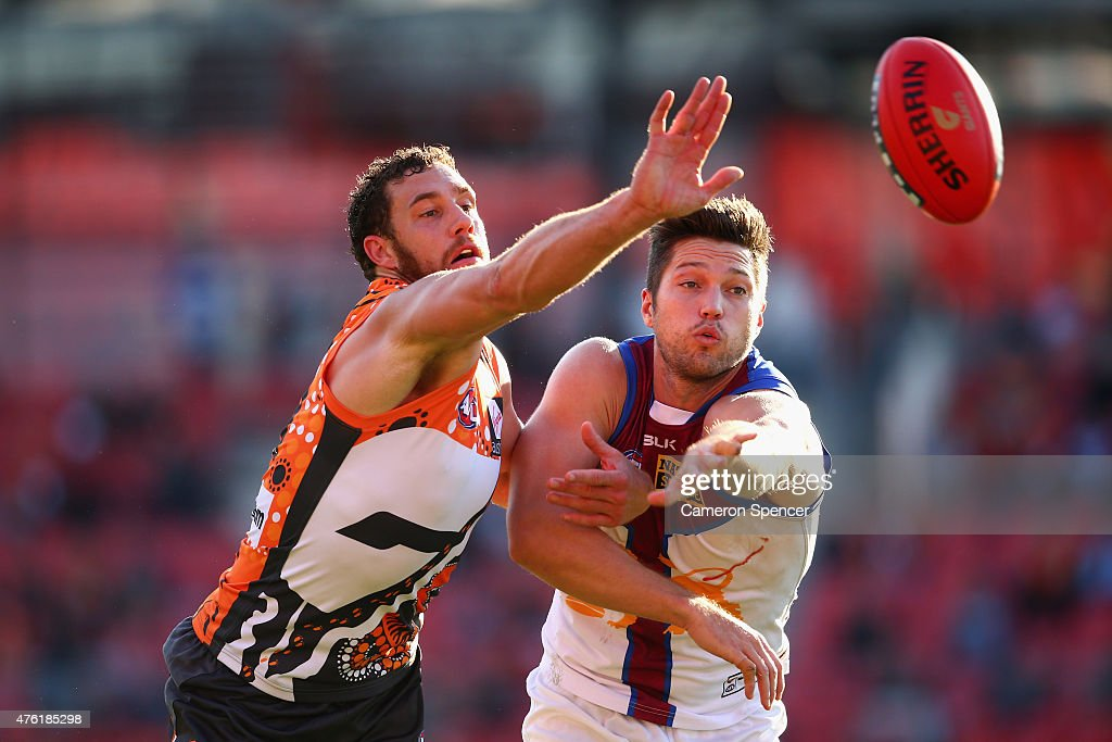 Shane Mumford of the Giants and Stefan Martin of the Lions contest the ball during the round 10 AFL match between the Greater Western Sydney Giants and the Brisbane Lions at Spotless Stadium on June 7, 2015 in Sydney, Australia.