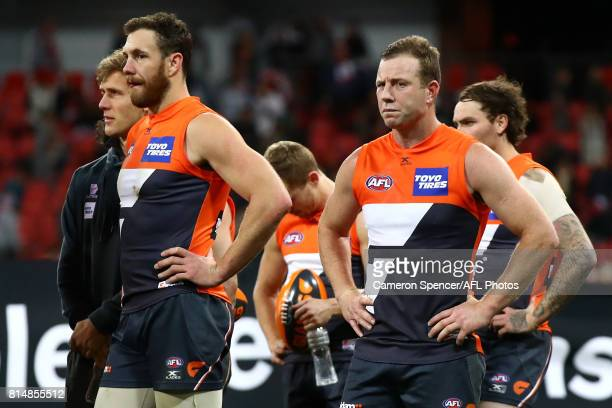 Shane Mumford of the Giants and Steve Johnson of the Giants look dejected after losing the round 17 AFL match between the Greater Western Sydney...