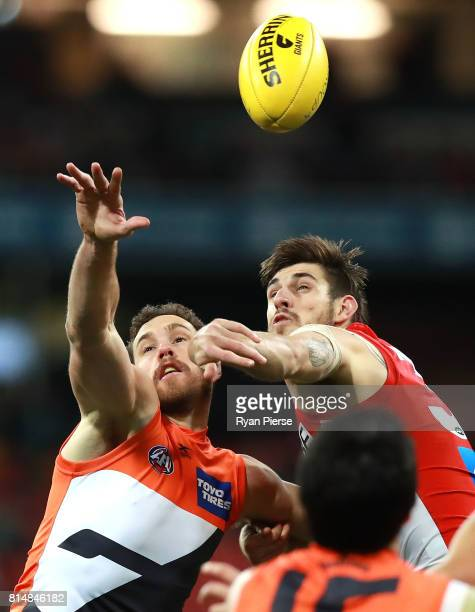 Shane Mumford of the Giants competes for the ball against Sam Naismith of the Swans during the round 17 AFL match between the Greater Western Sydney...