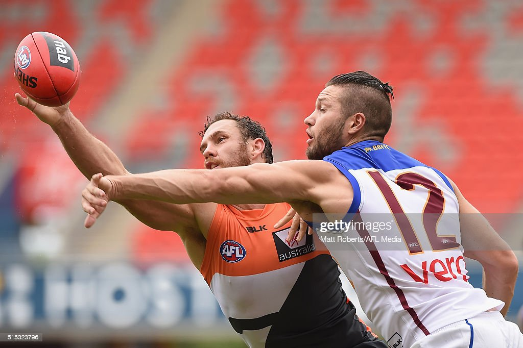 Shane Mumford of the Giants competes for the ball against Stefan Martin of the Lion during the NAB Challenge AFL match between the Brisbane Lions and the Greater Western Sydney Giants at Metricon Stadium on March 13, 2016 in Gold Coast, Australia.