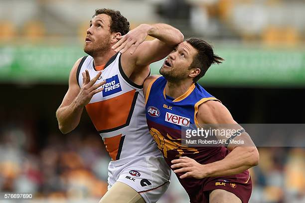Shane Mumford of the Giants competes for the ball against Stefan Martin of the Lions during the round 17 AFL match between the Brisbane Broncos and...
