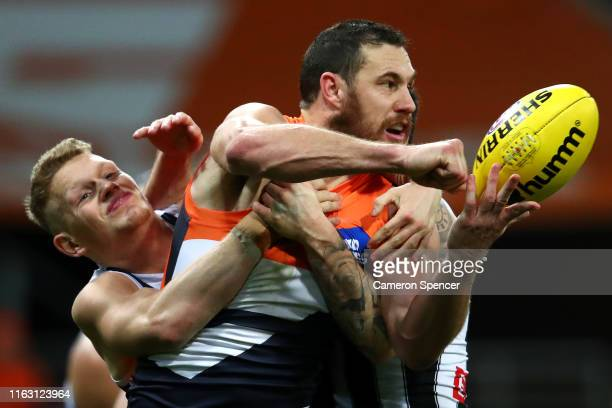 Shane Mumford of the Giants is tackled during the Greater Western Sydney Giants and the Collingwood Magpies at GIANTS Stadium on July 20 2019 in...