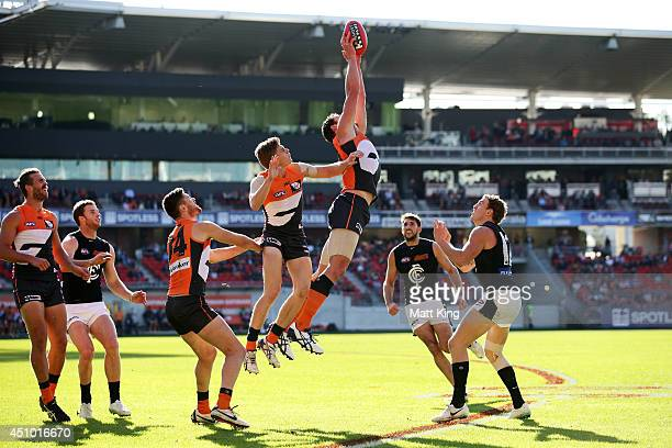 Shane Mumford of the Giants takes a mark during the round 14 AFL match between the Greater Western Sydney Giants and the Carlton Blues at Spotless...