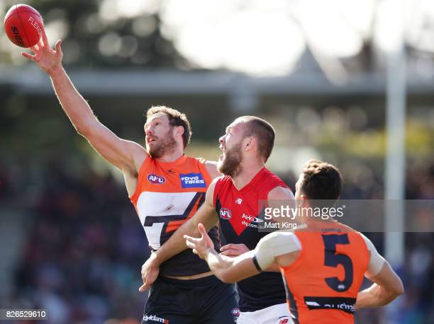 Shane Mumford of the Giants taps the ball during the round 20 AFL match between the Greater Western Sydney Giants and the Melbourne Demons at UNSW...