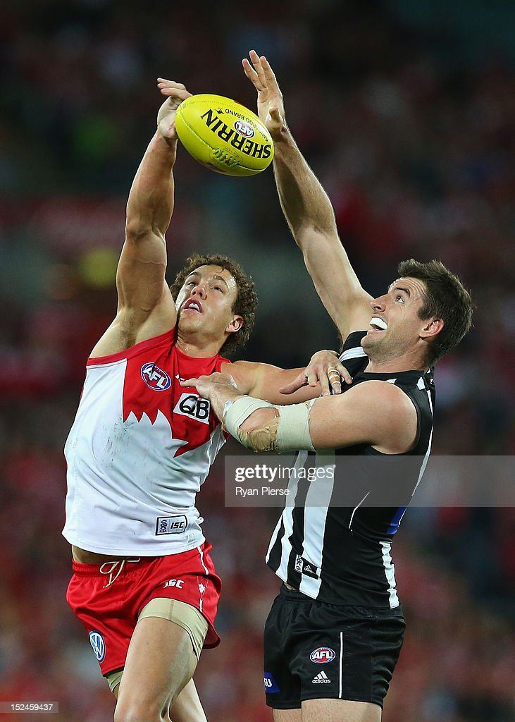 Shane Mumford of the Swans competes in the ruck against Darren Jolly of the Magpies during the second AFL Preliminary Final match between the Sydney Swans and the Collingwood Magpies at ANZ Stadium on September 21, 2012 in Sydney, Australia.