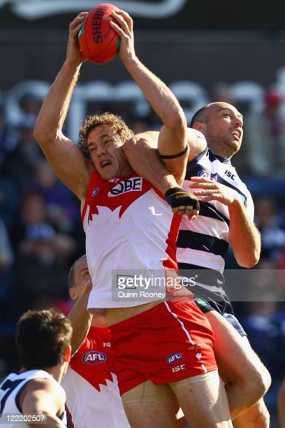Shane Mumford of the Swans marks infront of James Podsiadly of the Cats during the round 23 AFL match between the Geelong Cats and the Sydney Swans...