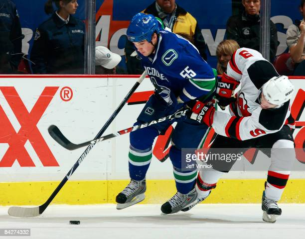 Shane O'Brien of the Vancouver Canucks and Zach Parise of the New Jersey Devils battle for the puck during their game at General Motors Place on...