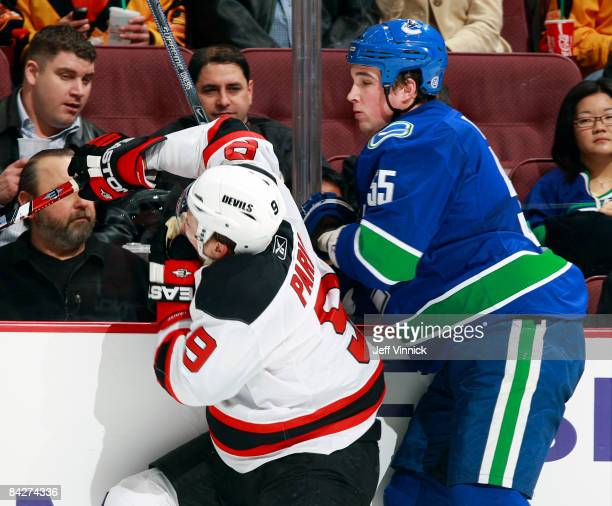 Shane O'Brien of the Vancouver Canucks high sticks Zach Parise of the New Jersey Devils during their game at General Motors Place on January 13 2009...