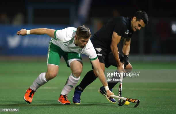 Shane O'Donoghue of Ireland battles with Nick Ross of New Zealand during day 8 of the FIH Hockey World League Men's Semi Finals 5th/ 6th place match...