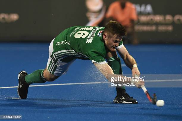 Shane O'Donoghue of Ireland scores his team's second goal from the penalty corner during the FIH Men's Hockey World Cup Group B match between Ireland...
