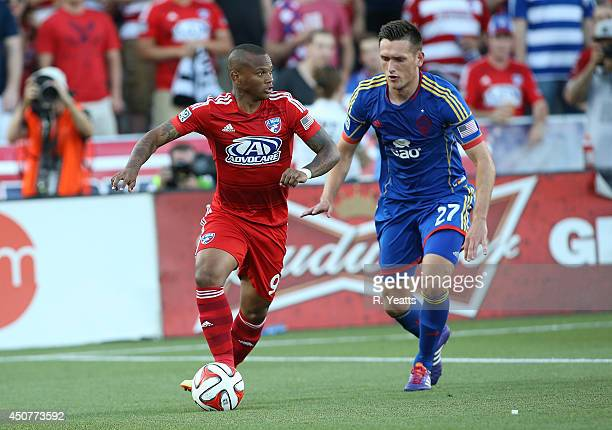 Shane O'Neill of Colorado Rapids chases down Andres Escobar of FC Dallas at Toyota Stadium on June 7 2014 in Frisco Texas