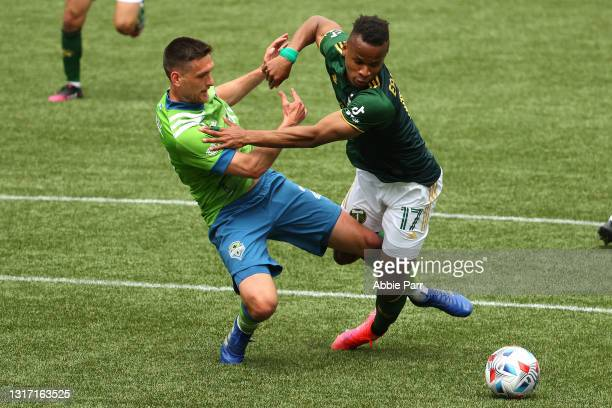 Shane O'Neill of Seattle Sounders and Jeremy Ebobisse of Portland Timbers battle for possession in the second half at Providence Park on May 09, 2021...