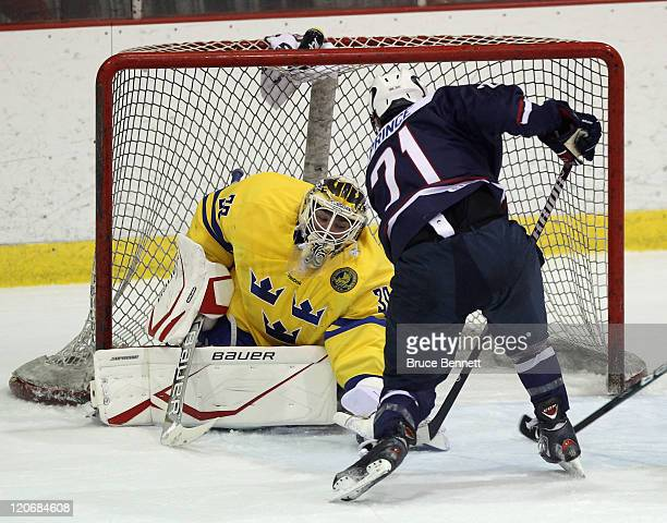 Shane Prince of Team USA is stopped by Johan Gustafsson of Team Sweden at the Lake Placid Olympic Center on August 8 2011 in Lake Placid New York