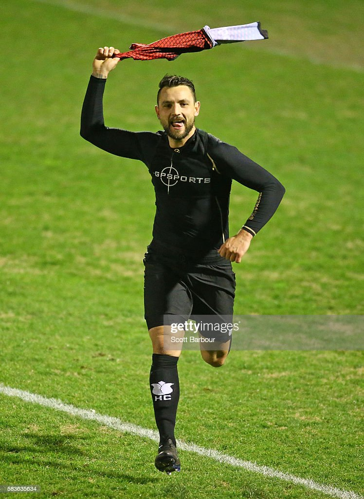 Shane Rexhepi of Hume City celebrates after scoring the final penalty goal to win the FFA Cup round of 32 match between Hume City and Marconi Stallions at ABD Stadium on July 27, 2016 in Melbourne, Australia.