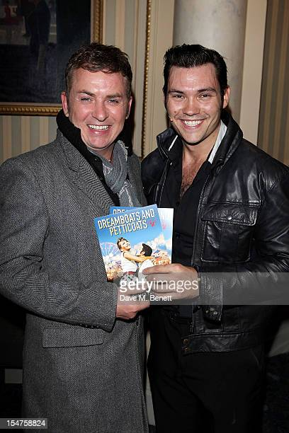 Shane Richie and Sam Attwater pose in the foyer following the press night performance of 'Dreamboats and Petticoats' after moving to Wyndhams Theatre...
