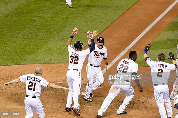 Shane Robinson Aaron Hicks Kurt Suzuki Miguel Sano and Brian Dozier of the Minnesota Twins celebrate a walkoff win against the Texas Rangers after...