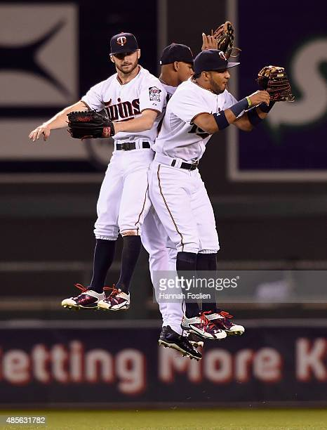 Shane Robinson Byron Buxton and Eddie Rosario of the Minnesota Twins celebrate a win of the game against the Houston Astros on August 28 2015 at...
