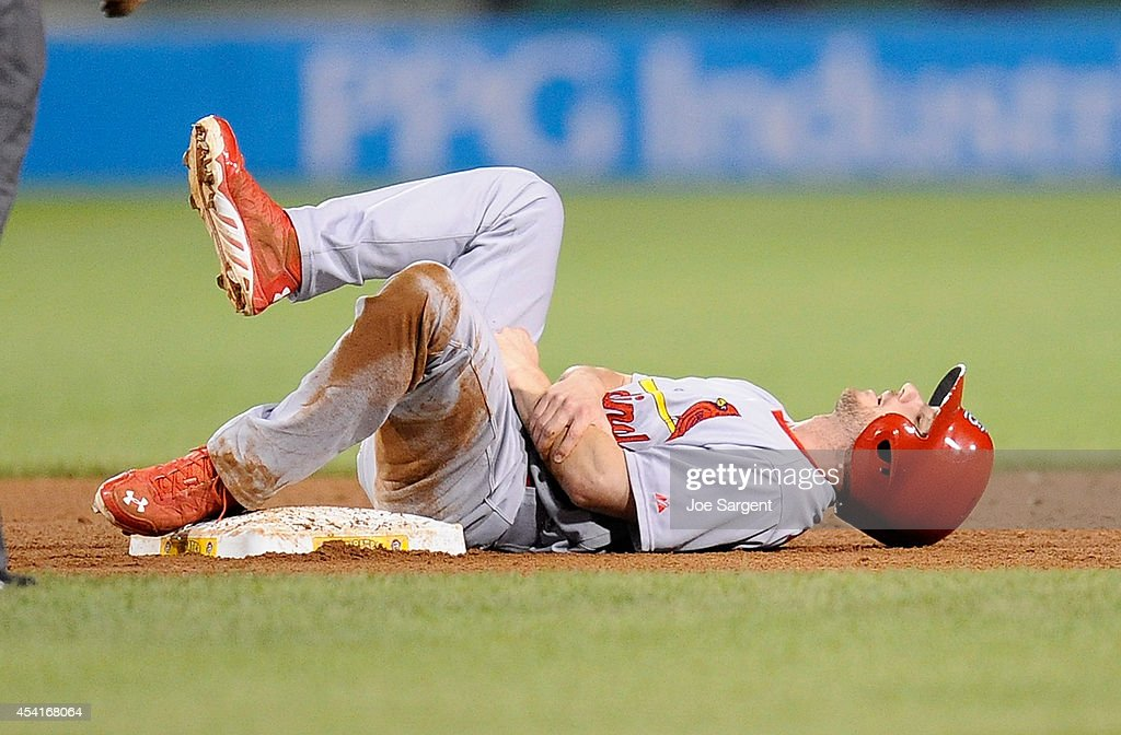 Shane Robinson #43 of the St. Louis Cardinals lies on the ground after being injured on a steal attempt during the ninth inning against the Pittsburgh Pirates on August 25, 2014 at PNC Park in Pittsburgh, Pennsylvania.