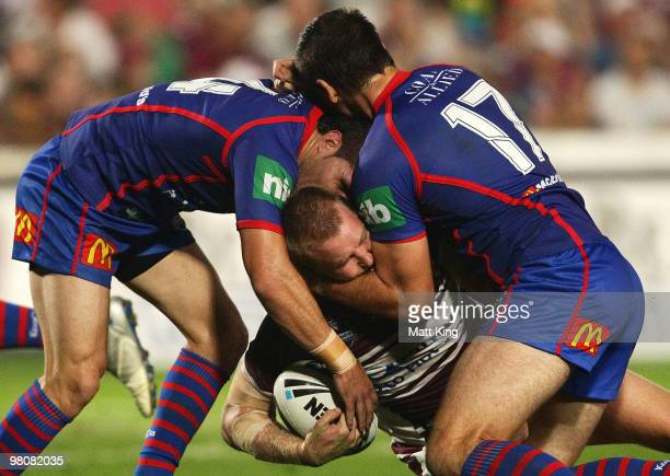 Shane Rodney of the Sea Eagles is tackled during the round three NRL match between the Manly Warringah Sea Eagles and the Newcastle Knights at...