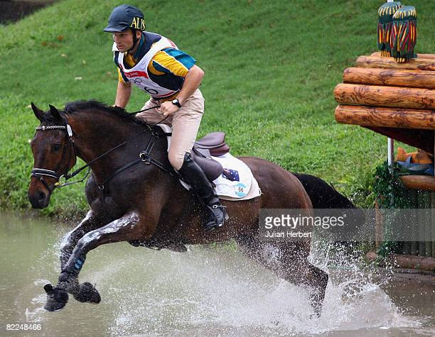 Shane Rose of Australia and All Luck go through the water jump during the Cross Country section of the Equestrian event at the Beas River Equestrian...