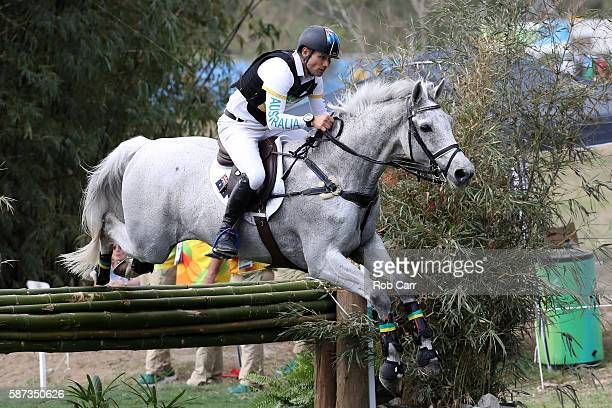 Shane Rose of Australia riding Cp Qualified clears a jump during the Cross Country Eventing on Day 3 of the Rio 2016 Olympic Games at the Olympic...