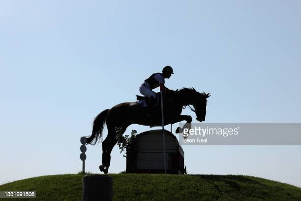Shane Rose of Team Australia riding Virgil clears a jump during the Cross Country Eventing on day nine of the Tokyo 2020 Olympic Games at Sea Forest...