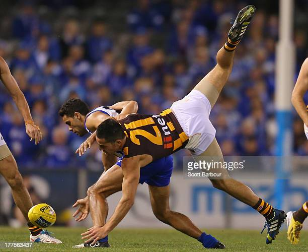 Shane Savage of the Hawks and Daniel Wells of the Kangaroos compete for the ball during the round 22 AFL match between the North Melbourne Kangaroos...