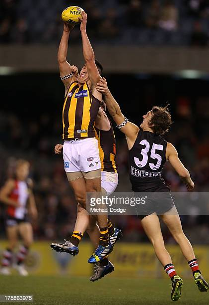 Shane Savage of the Hawks marks the ball against Josh Saunders of the Saints during the round 20 AFL match between the St Kilda Saints and the...