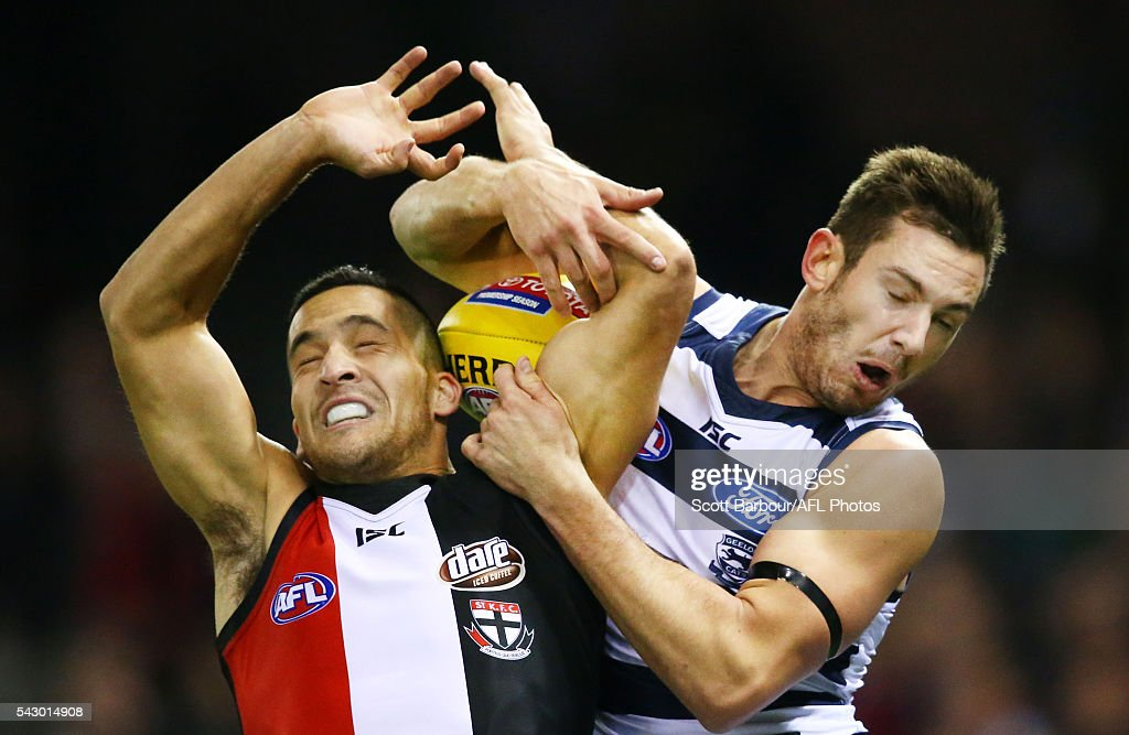 Shane Savage of the Saints and Daniel Menzel of the Cats compete for the ball during the round 14 AFL match between the St Kilda Saints and the Geelong Cats at Etihad Stadium on June 25, 2016 in Melbourne, Australia.