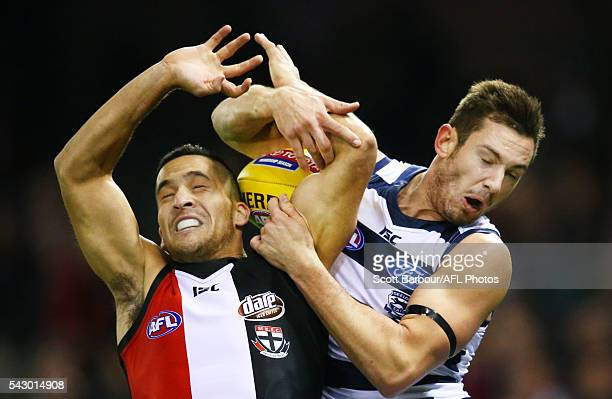 Shane Savage of the Saints and Daniel Menzel of the Cats compete for the ball during the round 14 AFL match between the St Kilda Saints and the...