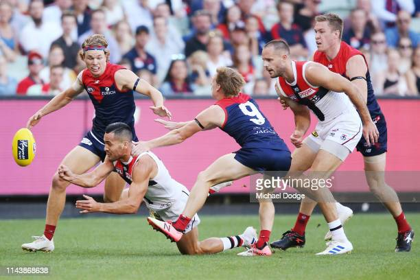 Shane Savage of the Saints handballs from Charlie Spargo of the Demons during the round 5 AFL match between Melbourne and St Kilda at Melbourne...