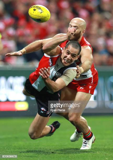 Shane Savage of the Saints is tackled by Jarrad McVeigh of the Swans during the round 18 AFL match between the Sydney Swans and the St Kilda Saints...