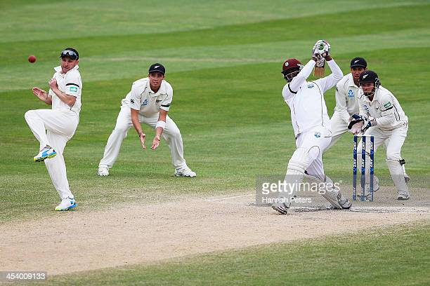 Shane Shillingford of the West Indies drives the ball away for four runs during day five of the first test match between New Zealand and the West...
